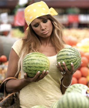 The melons are the only natural thing about this picture.